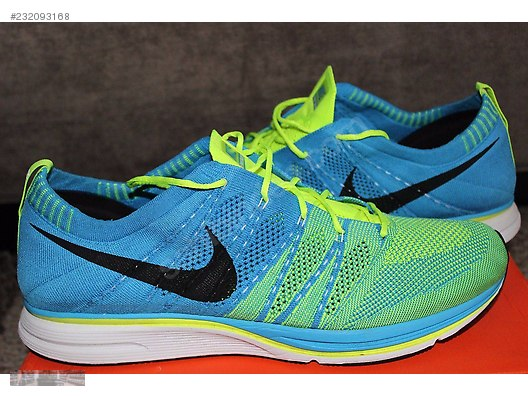 06bb7191891f NIKE FLYKNIT TRAINER BLUE GLOW VOLT 532984 447 at ...